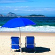 Deckchair and umbrella on ipanema beach — Stock Photo