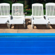 White deckchair by pool — Stock Photo #12684284