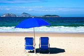 Deckchair and umbrella on ipanema beach — Stock Photo