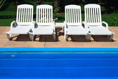 White deckchair by the pool — Stock Photo