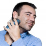 Man portrait shaving electrique razor — Stock Photo #13653274