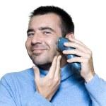Man portrait shaving electrique razor — Stock Photo #13653276