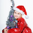 Little girl preparing christmas tree — Stock Photo