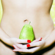 Woman holding a pear — Stock Photo