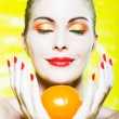 Woman Portrait smelling a citrus fruit smiling — Стоковая фотография