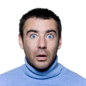 Expressive portrait on isolated background of a stubble man stun surprised — Stock Photo