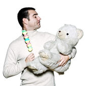 Childish man with a toy and teddy bear — Stock Photo