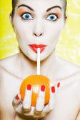 Beautiful Woman Portrait Drinking orange juice amazed — Stock Photo