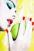 Woman Portrait holding an apple — Stock Photo