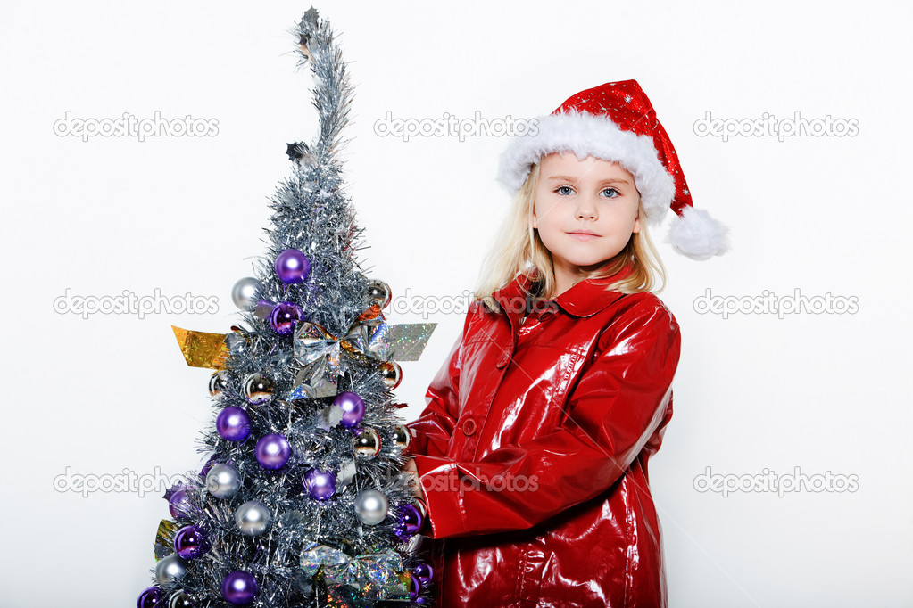 Indoors picture of a little girl preparing christmas tree on isolated white background — Stock Photo #13653770