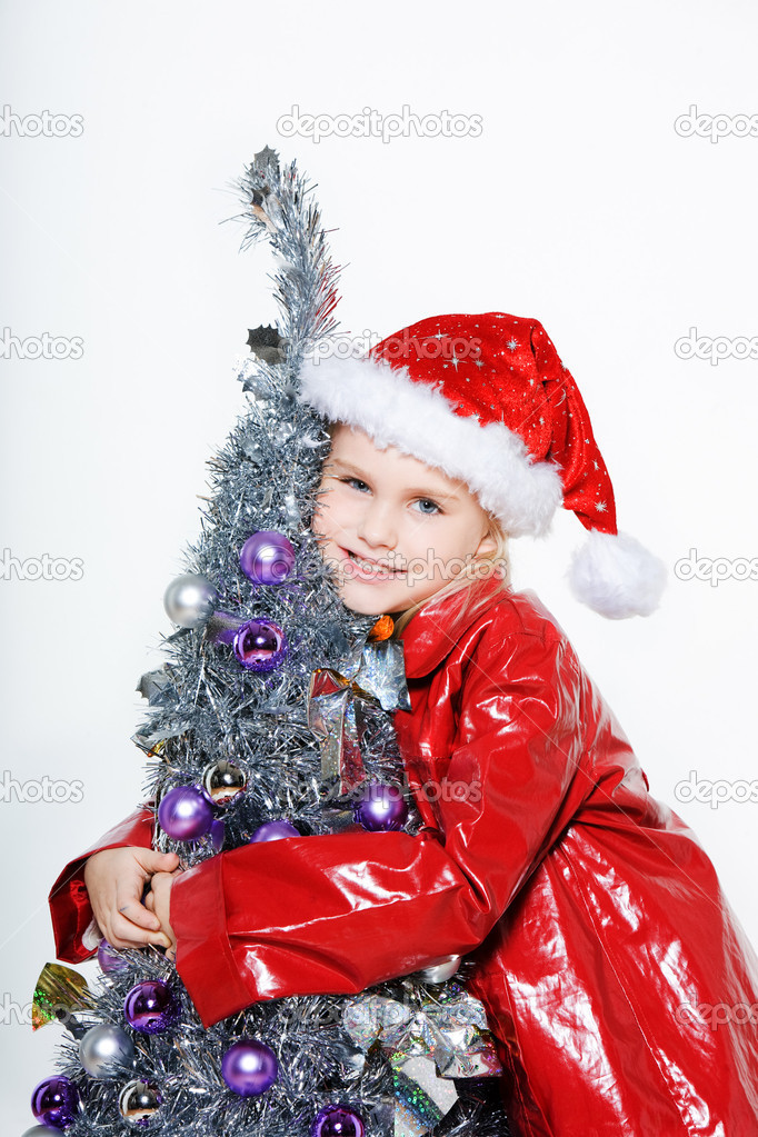 Indoors picture of a little girl preparing christmas tree on isolated white background — Stock Photo #13653771