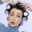 Hair-curlers victim - Stock Photo