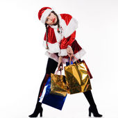 Young beautiful woman dressed with santa claus costume preparing christmas shopping — Stock Photo
