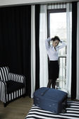 Woman arrive in a hotel bedroom — Stock Photo