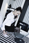 Woman phone call in a hotel bedroom — Stock Photo
