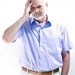 Migraine or memory loss illness senior man headache — Stock Photo