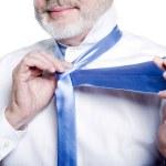 Man senior getting dressed tying windsor necktie — Stock Photo