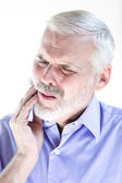 Senior man portrait frown toothache — Stock Photo
