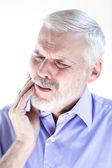 Senior man portrait frown toothache — Stock Photo