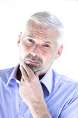 Senior man portrait puckering distrust — Stock Photo
