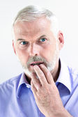 Senior man portrait stun pensive — Stock Photo