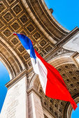 Arc of triumph with the french flag paris city France — Stock Photo