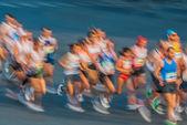 In motion blur running paris marathon france — Stock Photo