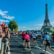 People running paris marathon france - Stock Photo