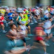 People in motion blur running paris marathon france - Stock Photo