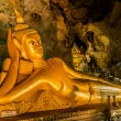 Reclining Buddha suwankuha temple Phuket thailand - Stock Photo