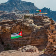 Jordflags floating in nabatecity of petra — Stock Photo #26707335