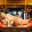 Reclining statue in the The Jade Buddha Temple shanghai china — Stock Photo #26707495