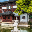 Statue on pond in Fang Bang Zhong Lu old city shanghai china — Stock Photo #26707779