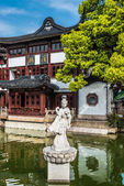 Statue on a pond in Fang Bang Zhong Lu old city shanghai china — Stock Photo
