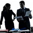 Busy smiling business woman man couple silhouette — Stock Photo