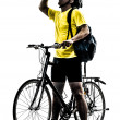 Man bicycling mountain bike drinking silhouette — Stock Photo