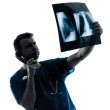 Doctor surgeon radiologist on the phone examining lung torso x- — Stock Photo #30742187