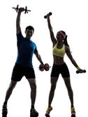 Woman exercising fitness workout with man coach — Zdjęcie stockowe
