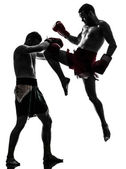 Two men exercising thai boxing silhouette — Foto Stock