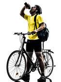 Man bicycling mountain bike drinking silhouette — Stock Photo