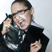 Business woman under pressure on the telephone — Stock Photo
