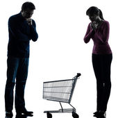 Couple woman man sad with empty shopping cart silhouette — Stock Photo