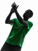 African man soccer player applauding silhouette — Stock Photo