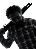 Man serial killer with shotgun silhouette portrait — Stock Photo