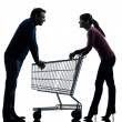 Couple woman man with shopping cart dating flirting silhouette — Stock Photo