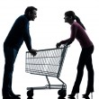 Couple woman man with shopping cart dating flirting silhouette — Stock Photo #31159357