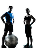 Man woman exercising workout fitness ball — Stock Photo
