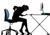 Business woman sitting backache pain silhouette — Stock Photo
