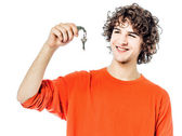 Young man holding keys portrait — Stock Photo