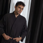 Handsome man in a bathrobe — Stock Photo